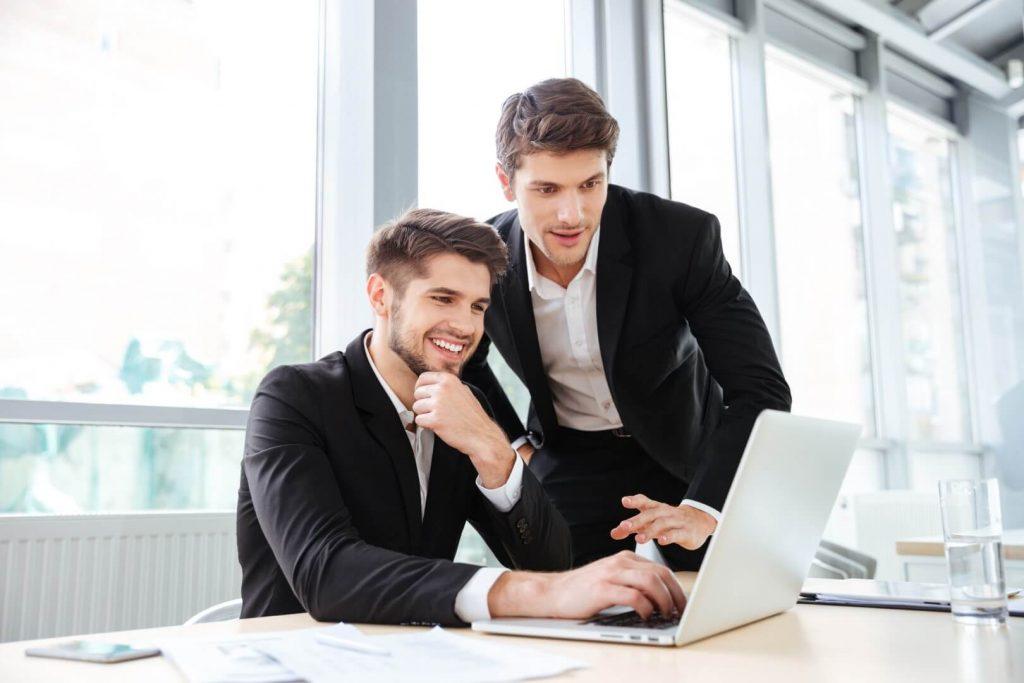 two cheerful young businessmen vasi teknoloji